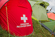 The end is nigh. It is the morning of the last full festival day. Peopel have sore heads but some people are disposing of damaged kit (despite the official message to leave no tents/trace) and preparing to leave through the continuing muddy conditions which make navigation a long slow process. The 2014 Glastonbury Festival, Worthy Farm, Glastonbury. 27 June 2013.