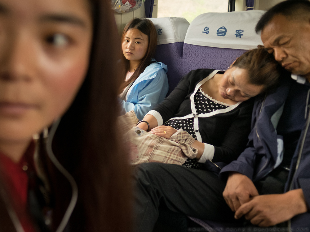 A family travelling together. Life in the seating wagons in the train from Hong Kong to Urumqi, Xinjiang.