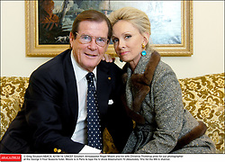 © Greg Soussan/ABACA. 42159-14. UNICEF Goodwill Ambassador Roger Moore and his wife Christina Tholstrup pose for our photographer at the George V Four Seasons hotel. Moore is in Paris to tape the tv show Absolument 70 (Absolutely 70's) for the M6 tv channel.