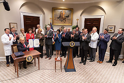 October 10, 2018 - Washington, DC, United States of America - U.S President Donald Trump holds up the signed S. 2553- the Know the Lowest Price Act and S.2553- the Patients Right to Know Act following a signing ceremony in the Roosevelt Room of the White House October 10, 2018 Washington, DC. (Credit Image: © Shealah Craighead via ZUMA Wire)