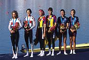Sydney, AUSTRALIA, LW2X medal ceremony Left to right,  Silver medallsit GER LW2X BLASBERG, Claudia / VIEHOFF, Valerie, centre Gold medallist ROM LW2X,   BURCICA, Constanta / TAMAS, Angela and USA LW2X  bronze medallist,  COLLINS, Christine / GARNER, Sarah at the 2000 Olympic Regatta, Penrith Lakes. [Photo Peter Spurrier/Intersport Images] 2000 Olympic Rowing Regatta00085138.tif