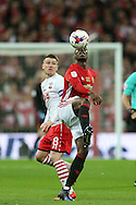 Paul Pogba of Manchester Utd ® gets to the ball ahead of Steven Davis of Southampton (l).  EFL Cup Final 2017, Manchester Utd v Southampton at Wembley Stadium in London on Sunday 26th February 2017. pic by Andrew Orchard, Andrew Orchard sports photography.