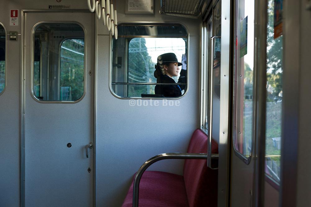 female conductor on the Kintetsu line train near Nara Japan
