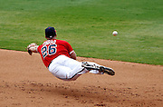 ATLANTA - AUGUST 29:  Second baseman Brooks Conrad #26 of the Atlanta Braves dives unsuccessfully for a ground ball during the game against the Florida Marlins at Turner Field on August 29, 2010 in Atlanta, Georgia.  The Braves beat the Marlins 7-6.  (Photo by Mike Zarrilli/Getty Images)