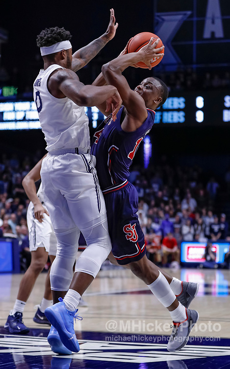 CINCINNATI, OH - MARCH 09: Mustapha Heron #14 of the St. John's Red Storm shoots the ball against Tyrique Jones #0 of the Xavier Musketeers at Cintas Center on March 9, 2019 in Cincinnati, Ohio. (Photo by Michael Hickey/Getty Images) *** Local Caption *** Mustapha Heron; Tyrique Jones