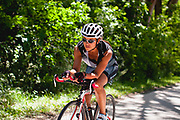 2013 June 16 - One of Lululemon's local ambassadors running and cycling at a park in Elkhorn, Nebraska.