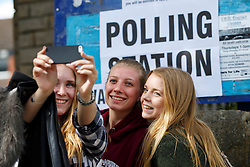 © Licensed to London News Pictures. 07/05/2015. LONDON, UK. Young people taking a 'selfie' after voting in the 2015 General Election at Broomhall Centre Polling Station in Sheffield Hallam Constituency on Thursday, 7 May 2015. Photo credit: Tolga Akmen/LNP