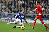 Photo: Paul Thomas.<br /> Everton v Middlesbrough. The Barclays Premiership.<br /> 06/11/2005.<br /> <br /> Everton's Andy Van Der Meyde goes in for a tackle on Stuart Parnaby.
