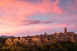 Pitilogani Sunset. Pitigliano is located in Tuscany halfway from Florence and Rome, perched atop a volcanic tufa ridge. Its unmistakable skyline makes it stand out from kilometres away and gives Pitigliano a surreal charm. It is also known as Little Jerusalem (Piccola Gerusalemme) due to the long-standing presence of a Jewish community. Prior to this particular part of history, Pitigliano has an ancient past, with centuries of changes in civilizations and cultures.