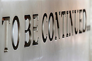 To Be Continued text debossed in marble