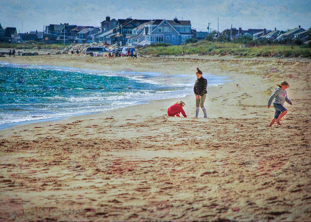 Three children playing at East Beach in Rhode Island. Charlestown and Misquamecut, Rhode Island.
