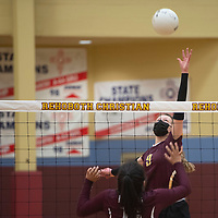 Rehoboth Christian's Eden Sun (9) reaches for the ball during their varsity volleyball match against the Ramah Mustangs Tuesday in Rehoboth. Rehoboth won the match 3-0.