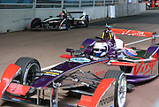 Sam Bird exiting in front of a Dragon racing driver during the FIA Formula E Visa London ePrix  at Battersea Park, London, United Kingdom on 28 June 2015. Photo by Matthew Redman.