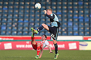Jason McCarthy of Wycombe Wanderers and Charlie Lee of Stevenage both attempt to go for the ball. Skybet football league two match, Wycombe Wanderers  v Stevenage Town at Adams Park  in High Wycombe, Buckinghamshire on Saturday 12th March 2016.<br /> pic by John Patrick Fletcher, Andrew Orchard sports photography.