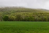 Town of Cornwall, New York - Clouds cover the upper part of Schunnemunk Mountain on the morning of  May 3, 2019.