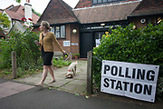 Dog owning voter leaves the polling station for the UK 2017 general elections outside St. Barnabas Parish Hall in Dulwich Village  on 8th June 2017, in London, England.