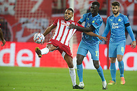 PIRAEUS, GREECE - OCTOBER 21: Youssef El-Arabi of Olympiacos FC controls the ball in front of Pape Gueye of Olympique de Marseille during the UEFA Champions League Group C stage match between Olympiacos FC and Olympique de Marseille at Karaiskakis Stadium on October 21, 2020 in Piraeus, Greece. (Photo by MB Media)