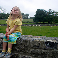 Europe, Ireland, Donegal. Kid on wall in Ireland.