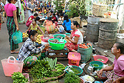Vegetables for sale at an early morning street market in Yangon, Myanmar on 18th May 2016.  A large variety of local products are available for sale in fresh markets all over Yangon, all being sold on small individual stalls