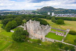 Elevated view of Craigmillar Castle and skyline of Edinburgh, Scotland UK.