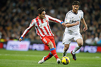 01.12.2012 SPAIN -  La Liga 12/13 Matchday 14th  match played between Real Madrid CF vs  Atletico de Madrid (2-0) at Santiago Bernabeu stadium. The picture show Xabier Alonso (Spanish midfielder of Real Madrid) and Jorge Resurreccion Koke (Spanish midfielder of At. Madrid)