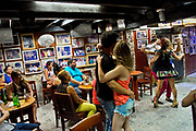 People dancing Salsa in a bar in Cartagena, Colombia.