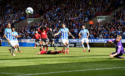 Manchester United's Marcus Rashford slips as he shoots at goal during the Premier League match at the John Smith's Stadium, Huddersfield.