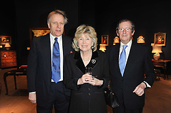 Left to right, COUNT RABEN and The 29th Knight of Glin DESMOND FITZGERALD and his wife OLDA at a party to celebrate the publication of The irish Country House written by The Knight of Glin and James Peill with photographs by James Fennell, held at Christie's, King Street, London on 24th January 2011.