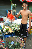 Fresh fruit at Phuket Town market. Though most visitors to Phuket head straight for one of the beaches, Phuket Town is interesting in itself.  Besides all the historical architecture, the market bustles with activity - especially in the early morning with few tourists on the ground, in contrast to the beach resorts where there is nothing but.
