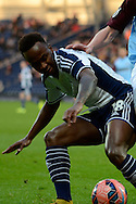 Saido Berahino shields the ball during the The FA Cup match between West Bromwich Albion and Gateshead at The Hawthorns, West Bromwich, England on 3 January 2015. Photo by Alan Franklin.