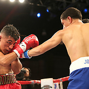 Olympian Antonio Vargas (R) fights against Luis Fernando Saavedra during a Telemundo boxing match between at Osceola Heritage Park on Friday, February 23, 2018 in Kissimmee, Florida.  (Alex Menendez via AP)