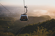 """Tirana, Albania - September 6, 2013: People ride in a cable car on the """"Dajti Ekspres"""" on the outskirts of Tirana. The Dajti Ekspres is 4670 meters in length, has an elevation gain of 812 meters, and has an average slope of 19%."""