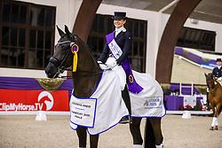 Kronberg, Gestüt Schafhof, KRONBERG _ Int. Festhallen Reitturnier Schafhof Edition 2020,<br /> <br /> NUXOLL Sandra (AUT), Bonheur de La Vie<br /> - Siegerehrung -<br /> Louisdor-Preis - Finale 2020 <br /> Nachwuchspferde Grand Prix für 8 - 10j. Pferde / Finale<br /> Grand Prix<br /> Dressurprüfung Kl.S***<br /> <br /> 20. December 2020<br /> © www.sportfotos-lafrentz.de/Stefan Lafrentz