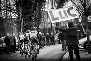 Famed cycling fan Luc - who travels around cycle races with a banner showing his name. He used to old a banner advertising his wife's shop - until they got divorced. The view from the Commissaire's car - the race referee.  Brabantse Pijl 2013, a spring semi-classic cycle race which takes place in the Flemish Brabant region of Belgium. April 10, 2013