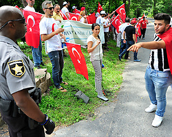 Protestors in support of Turkish president Erdogan rally outside the remote mountain compound of muslim cleric Fethullah Gulen Saturday, July 16, 2016 in Saylorsburg, PA.