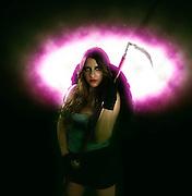 Grim reaper female DEATH carrying scythe