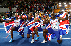 Great Britian's Chijindu Ujah (left), Zharnel Hughes (second left), Adam Gemili, and Harry Aikines-Aryeetey (right) celebrate during day six of the 2018 European Athletics Championships at the Olympic Stadium, Berlin.