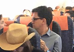 © Under license to London News Pictures. 19/05/2015.  Former Labour Party leader ED MILIBAND and his wife JUSTINE THORNTON on an EasyJet flight back to the UK after a holiday in Ibiza, Spain. Photo credit: Morning Star/LNP