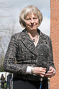 © Licensed to London News Pictures. 01/04/2015. Abingdon, UK. THERESA MAY holds a TV microphone. Home secretary, Theresa May and Nicola Blackwood, Parliamentary candidate for Abingdon visit Abingdon Police Station today, 1st April 2015, recent arrests for human exploitation, slavery and fraud. . Photo credit : Stephen Simpson/LNP