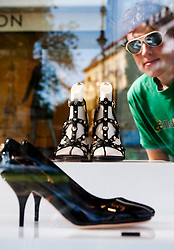 Luxury designer shoes on display in glass cabinet outside Louis Vuitton shop on Kurfurstendamm in Berlin Germany