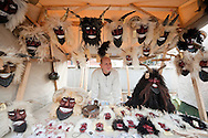 Mask-maker Gábor Litter selling his masks at the Busó carnival, Mohács, Hungary. The Busó carnival or Busójárás is inscribed on the UNESCO list of Intangible Cultural Heritage. © Rudolf Abraham