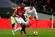 Ashley Young of Manchester United (L) in action with Son Heung-min of Tottenham Hotspur (R). Premier league match, Tottenham Hotspur v Manchester Utd at Wembley Stadium in London on Wednesday 31st January 2018.<br /> pic by Steffan Bowen, Andrew Orchard sports photography.