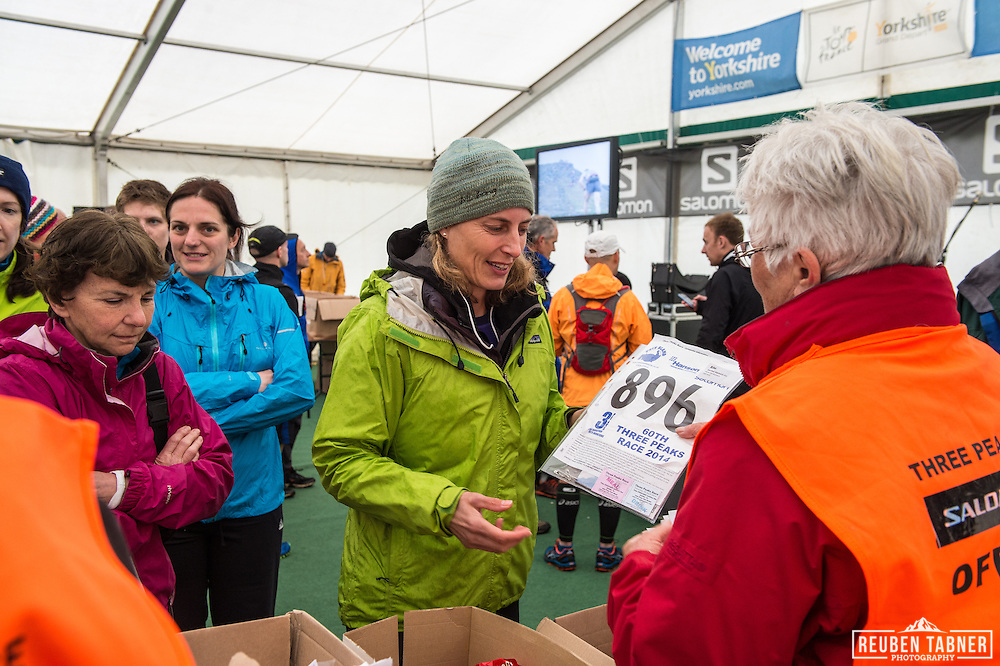 Runner 896, Rachel Slattery collects her race pack prior to the 60th Yorkshire Three Peaks Race.