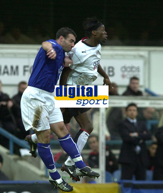 10/01/2004 - Photo  Peter Spurrier<br /> 2003/04 Barclaycard Premiership Fulham v Everton <br /> Ariel Challenge Louis Saha and David Unsworth leap for the high ball.