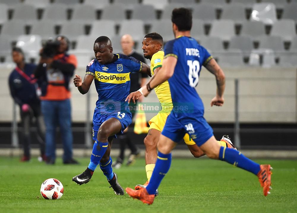 Cape Town-180818 Cape Town City striker Nana Akosah-Bempah tackled by Wayde Jooste  of Golden Arrows in a PSL match at Cape Town Stadium .photograph:Phando Jikelo/African News Agency/ANA