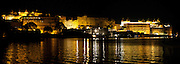 The City Palace at night across Lake Pichhola Udaipur.