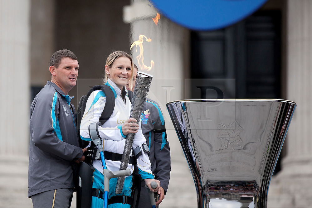 © Licensed to London News Pictures. 24/08/2012. LONDON, UK. Claire Lomas smiles as she prepares to light the Paralympic Cauldron in Trafalgar Square today (24/08/12). Ms Lomas, formerly a horse event rider, was paralysed from the chest down after being injured during the Osberton Horse Trials and completed the London Marathon in 2012. Photo credit: Matt Cetti-Roberts/LNP