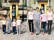 In the bath tub and on the ski slope: Photographer recreates a host of childhood holiday snaps 20 years on with her sisters<br /> <br /> A Finnish photographer set out to recreate childhood holiday pictures taken by her father 20 years ago with amusing and touching results.<br /> Wilma Hurskainen rounded up her three younger sisters and set off for the destinations they visited with their parents - and this time she directed the shots herself.<br /> The four siblings did their best to mimic the original images, which were taken between 1986 and 1990. They struck the same poses and imitated their facial expressions, acknowledging the difficulty encountered in family photos when everyone needs to look at the camera at the same time.<br /> They even tried to pay homage to their '80s fashions by wearing the same colours and styles of outfit - sporting matching tops or hoodies in different colours.<br /> In the series, titled 'Growth', Hurskainen snapped the scenes as closely as she could to her dad's efforts, to give a glimpse of how much the sisters have physically grown over the past 20 years.<br /> The matching sailor dresses might now be a thing of the past, but the siblings effortlessly slip into their younger roles - and now they are even taller than their mother.<br /> <br /> In one particularly poignant shot, the grown-up sisters pose on a sofa but cannot fully recreate the shot as their grandfather has since died.<br /> Hurskainen wrote on her website that she would love to get her sisters together again for a new set of the photos as they get older.<br /> The photographer told the My Modern Metropolis website: 'The most important thing is that in the end my sisters were pleased with the whole thing.<br /> 'It was sometimes a little hard finding the places of the original photos, finding the proper clothing and dealing with the emotions that emerged because of the process of digging up the past.'<br /> <br /> Photo shows: Outside the Swedish Royal Palace on Dro