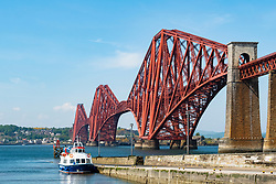 View of the historic Forth Bridge (Forth Railway Bridge) crossing the Firth of Forth between North and South Queensferry, UK