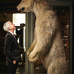 Paris, France. February 6, 2015. Claude d'Anthenaise, Chief Curator of the french Museum of Hunting and Nature, posing with a bear in his museum. Photo: Antoine Doyen